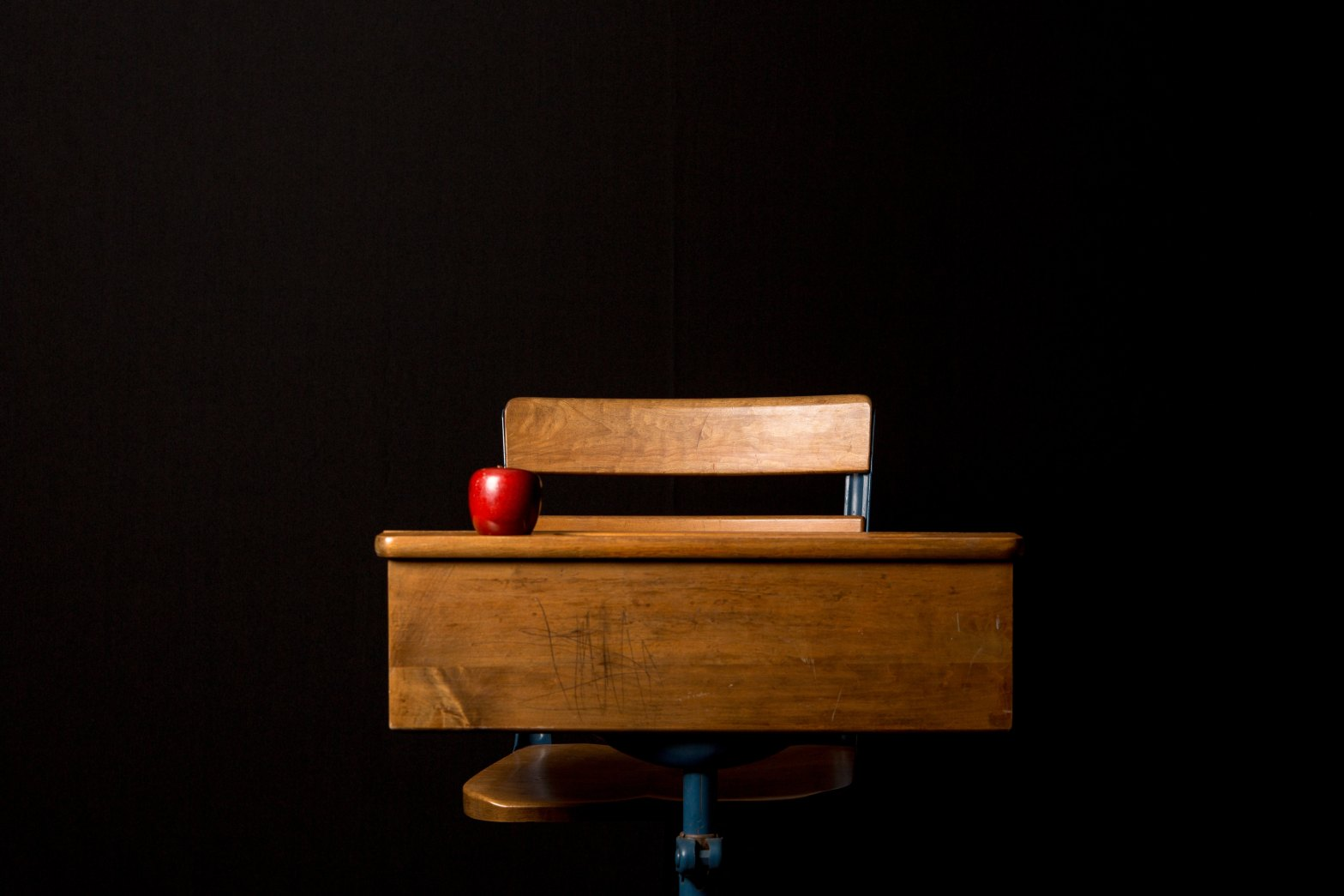 Apple on Desk. Photo by JJ Thompson on Unsplash.