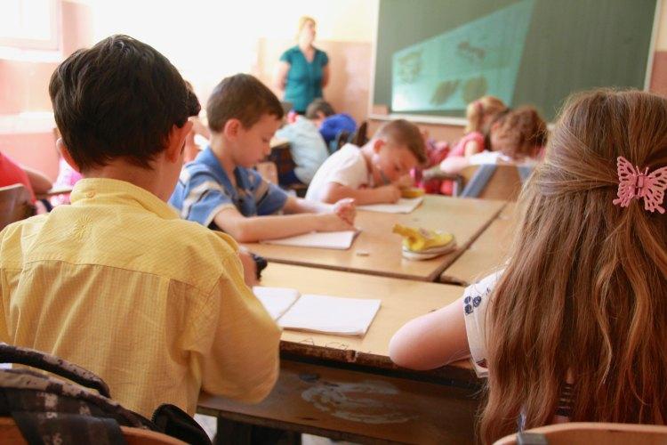 Kids in a classroom. Photo by Megan Soule on Unsplash.